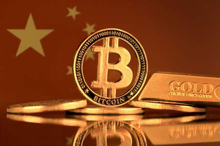 Physical version of Bitcoin, gold bar and China Flag.