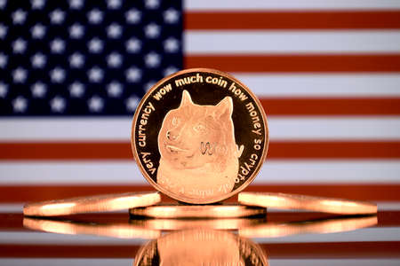 A physical version of Dogecoin (Cryptocurrency) and United States Flag.