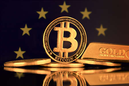 Physical version of Bitcoin, gold bar and European Union Flag.