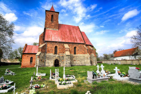 WROCLAW, POLAND - MAY 01, 2021: Roman Catholic Church of the Assumption of the Blessed Virgin Mary (15th century) in Wilczkow near Wroclaw, Poland, Europe. Stock Photo