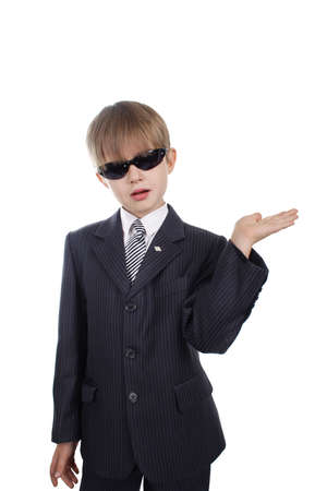 Close-up of boy in business suit. Shot in studio. Isolated with clipping path. photo