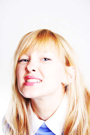 bared teeth: young lady is demonstrating her great teeth. Shot in studio.
