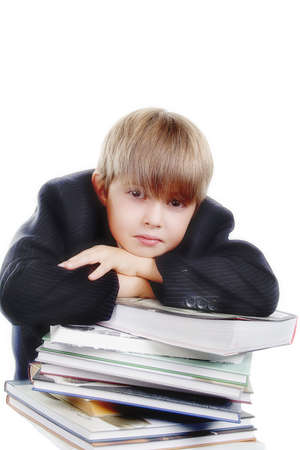 A young boy with his books, against white background. Stock Photo - 824010