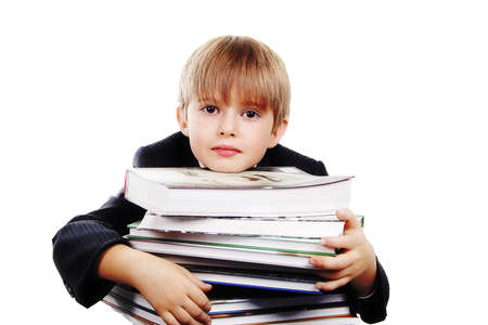 A young boy with his books, against white background. Stock Photo - 824013