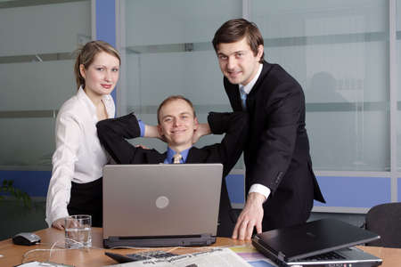 acquaintance: Group of 3 business people working together in the office. Stock Photo