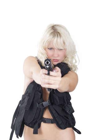 сooking: Portrait of a stylish sexy blonde in war uniform. Shot in studio.