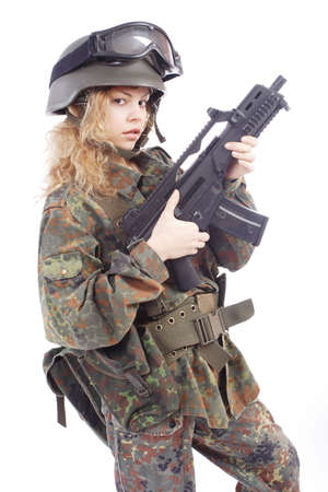 conforms: Shot of a beautiful girl holding gun. Uniform conforms to special services(soldiers) of the NATO countries. Shot in studio. Isolated on white. Stock Photo