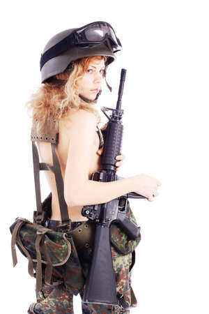 fighting styles: Shot of a beautiful girl holding gun. Uniform conforms to special services(soldiers) of the NATO countries. Shot in studio. Isolated on white. Stock Photo