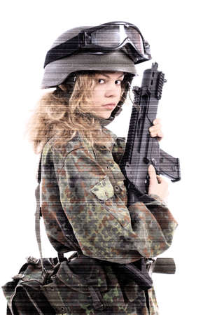 Shot of a beautiful girl holding gun. Uniform conforms to special services(soldiers) of the NATO countries. Shot in studio. Isolated on white. photo