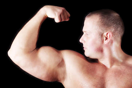 MUSCULAR MAN. ISOLATED ON BLACK. SHOT IN STUDIO. Stock Photo - 824112