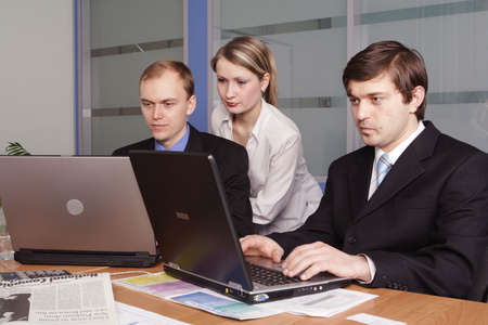 Group of 3 business people working together in the office. photo
