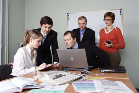 Group of 5 business people working together in the office. photo