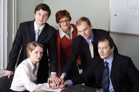 unanimous: Group of 5 business people working together in the office.