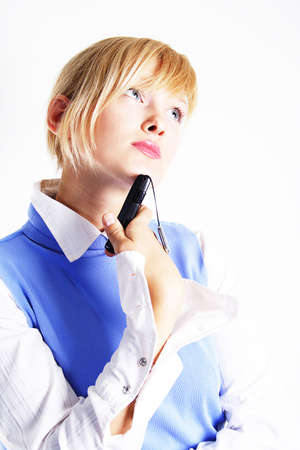 Dreaming business woman or student with mobile phone. Shot in studio.  Stock Photo - 804945