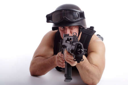 conforms: Shot of a soldier holding gun. Uniform conforms to special services(soldiers) of the NATO countries. Shot in studio. Isolated on white.