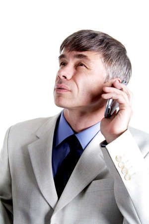 Portrait of a middle age businessman. Shot in studio. Isolated with clipping path. photo