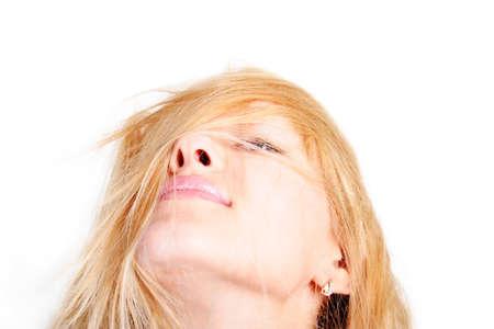 Portrait of a styled professional model. Theme: beauty, hair, hair fashion, haircare, fashion, flirt. Shot in studio.  photo