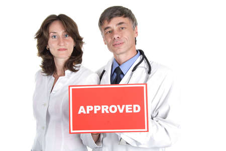 Two doctors with approved table. Stock Photo - 805170