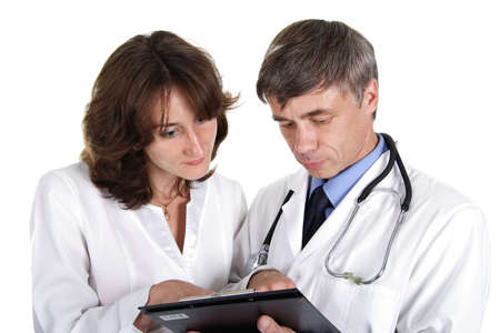 Two doctors review some case notes. photo