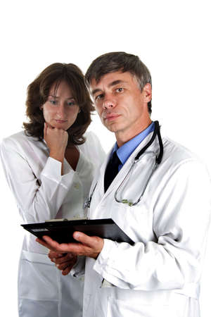 Two doctors review some case notes. Isolated with clipping path. photo
