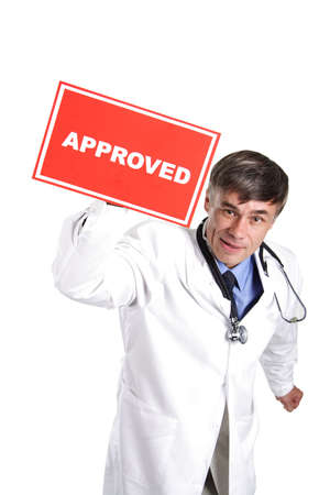 Portrait of senior doctor with approved table. Stock Photo - 805196