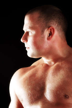 MUSCULAR MAN. ISOLATED ON BLACK. SHOT IN STUDIO. Stock Photo - 805180