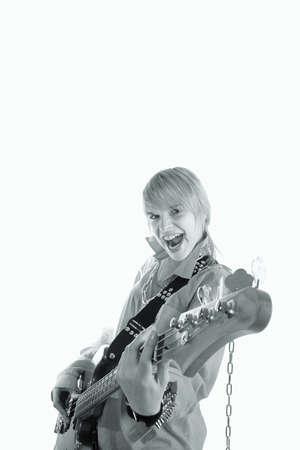 式と彼女のギターを演奏若い女性。 写真素材
