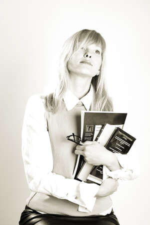 prospection: smart student with books. Shot in studio.