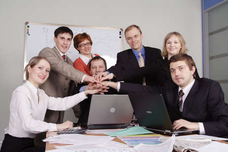 unanimous: Group of business people working together in the office.