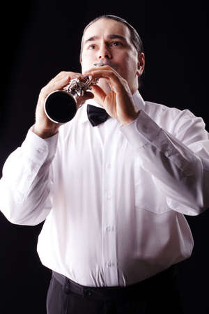 A man playing his wind instrument with expression. Stock Photo - 895759