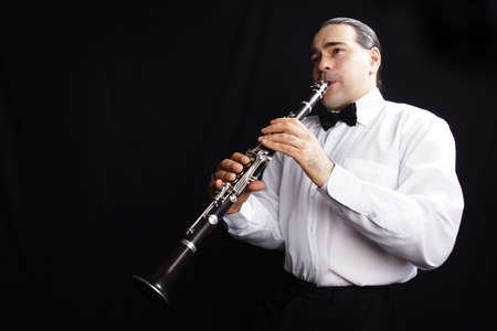 A man playing his wind instrument with expression. Stock Photo - 895761