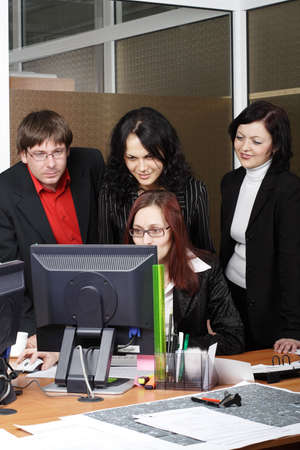 Group of 4 business people working together in the office. Stock Photo - 895768