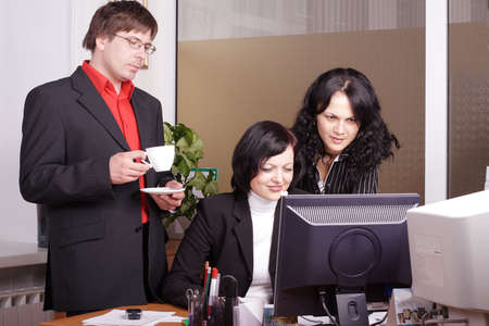 Group of 3 business people working together in the office. Stock Photo - 896145