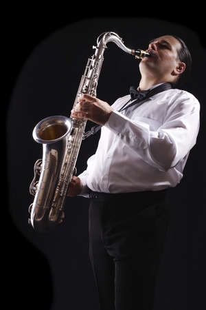 A man playing his wind instrument with expression. Stock Photo - 896173