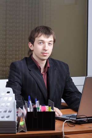 Portrait of a businessman in a working process photo