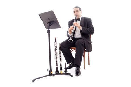 quintet: A man playing his wind instrument with expression.