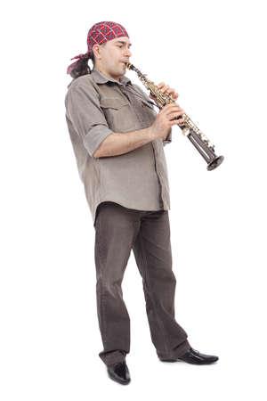 musicality: Un uomo che gioca il suo strumento di vento con lespressione. Archivio Fotografico