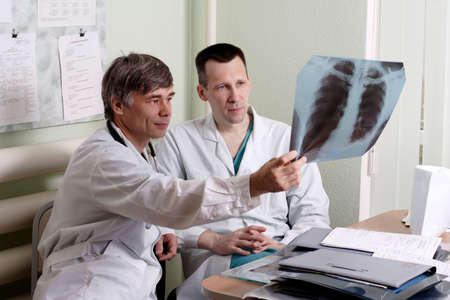 Two doctors review some case notes. Stock Photo - 937956