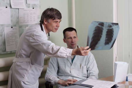 Two doctors review some case notes. Stock Photo - 937986