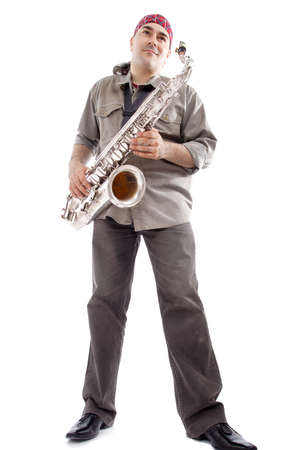 A man playing his wind instrument with expression. photo