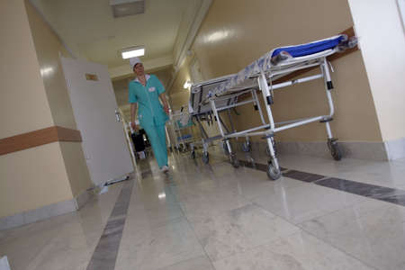 sickbed: Doctors are working - medicine  background. Shot in a hospital.