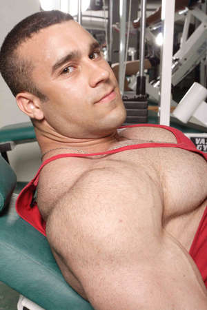 male muscles muscular pecs pectoral sexy young: The champion in a fitness center.