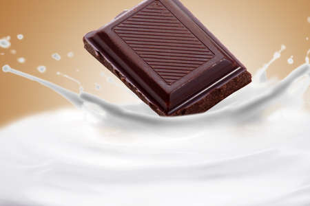 Fantastical milk and chocolate background. Drops, waves, splashes. Stock Photo