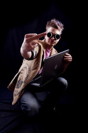 Portrait of a teens(hacker, student). Shot in studio. photo