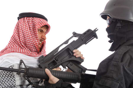conforms: Terrorist and a soldier holding gun. Uniform conforms to special services(soldiers) of the NATO countries.  Stock Photo