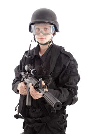 conforms: Shot of a soldier holding gun. Uniform conforms to special services(soldiers) of the NATO countries.  Stock Photo