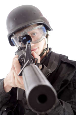 projectile: Shot of a soldier holding gun. Uniform conforms to special services(soldiers) of the NATO countries.  Stock Photo