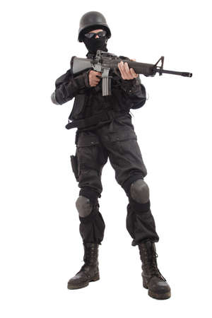 Shot of a soldier holding gun. Uniform conforms to special services(soldiers) of the NATO countries.  photo