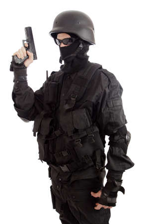 fatigues: Shot of a soldier holding gun. Uniform conforms to special services(soldiers) of the NATO countries.  Stock Photo