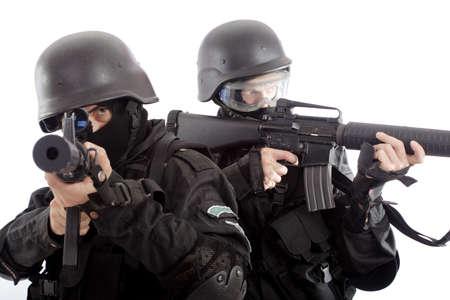 firearms: El tiro de un soldado que sostiene el Uniforme del arma se conforma con el services(soldiers) especial de los pa�ses de la OTAN.